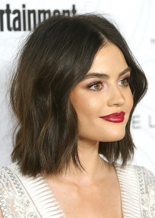 Lucy Hale waves