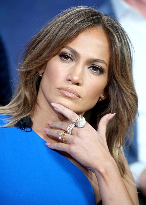 Jennifer Lopez hand on face