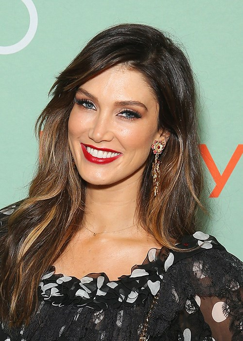 Delta Goodrem brow hair red lipstick