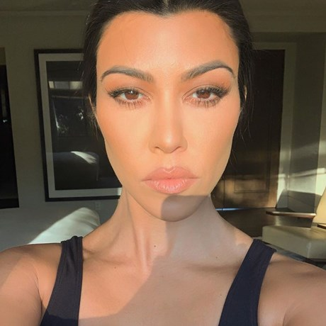 Kourtney Kardashian's Makeup Artists Reveals The Secret Behind Kourtney's Signature Dewy Skin Look